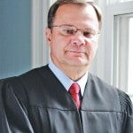 Coss finds himself in contempt for cell phone violation