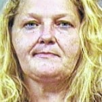 Woman accused of intimidating witness