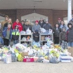 Scouts collect food for needy