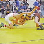 Carter moves to consolation round