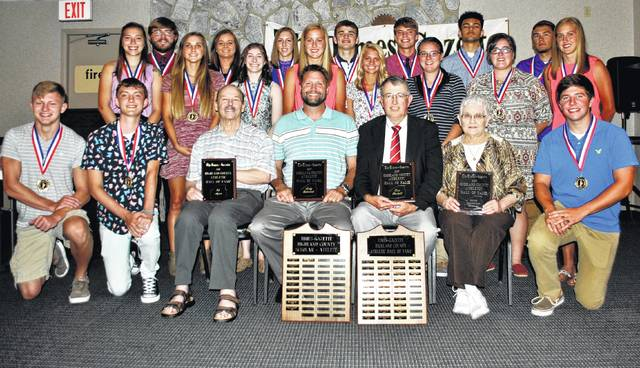"""Four honorees were inducted into The Times-Gazette's Highland County Athletic Hall of Fame Thursday night at the Ponderosa Banquet Center in Hillsboro. Shown in front and center, seated, from left, are Chris Duckworth, who accepted the honor on behalf of his grandfather, Ed Ayres; Chad Richmond, who accepted the honor on behalf of his father, Andy Richmond; Tom Purtell; and Janie Shoemaker, who accepted the honor on behalf of her father, Lloyd Chestnut, and the 1928 Marshall Class """"B"""" state championship basketball team. Hannah Binkley, standing behind Chad Richmond, was awarded The Times-Gazette Highland County Scholar Athlete Award for 2017. Also pictured are other scholar athletes."""