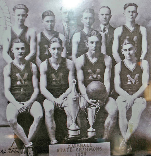 """The 1928 Marshall High School Class """"B"""" state championship basketball team is pictured above with its coaches and tournament trophies. Identification of those pictured was not available."""