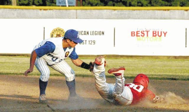 Caleb West of Whiteoak High School slides into second base on Friday at Shaffer Park. West is a member of the Hillsboro American Legion Post 129 baseball team; the team hosted a wood bat tournament June 16-18 finishing with a 2-2 record.