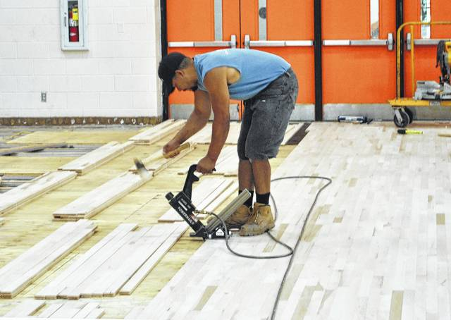Everett Harding, and employee of the Cincinnati Floor Company, installs new unfinished wood slats for the new gym floor at Whiteoak High School. The project began on June 1, 2017 with the removal of the previous flooring and is expected to be completed by August 1, 2017.