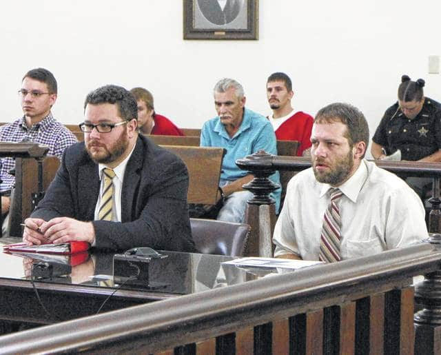 Bret Ledford, right, sits in court Wednesday with defense attorney Richard Furnish.