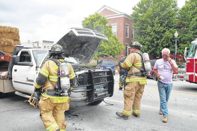 Hillsboro police and fire personnel responded Thursday afternoon to West Main Street in the center of town after a truck caught on fire while towing a load of straw. Jim Super of Sugartree Ridge told The Times-Gazette on scene that he was driving his 2001 Dodge Ram 3200 east on Main Street, hauling straw for his chickens, when someone told him the front end of his truck was smoking. Super said there were flames in the lower part of the engine cavity. Firefighters with the Paint Creek Joint EMS/Fire District responded and extinguished the blaze while Hillsboro police conducted traffic control. At press time, a tow truck was en route. No one was injured.