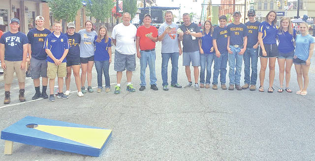 """On July 8 Hillsboro FFA members hosted their annual cornhole tournament at the Festival of the Bells. The members helped set up cornhole boards and kept track of scores for the participants. Lexey Hetzel said """"it went smoothly and was a great experience for the new officers and members."""" Twenty-two teams signed up to play. First, second and third place each received money for placing in the top three at the tournament. The rest of the proceeds go to the Hillsboro FFA chapter. The first place team was Sean Short and Jay Dotson. Second place was Gary and Ron. Pictured, from left, are Joe Helterbrand, Ryan Harless, Grant Crum, Jessica Moon, Heather Burba, Kirsten Harp, Gary, Ron, Jay Dotson, Sean Short, Jordan Williamson, Riley Burba, Casey Jordan, Spencer Rudy, Taylor Chaney, Kennedi Claycomb and Hannah Oyer."""
