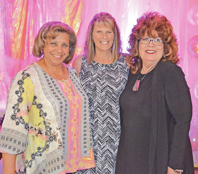 "The Times-Gazette's Sharon Hughes was the emcee for the Ladies Day Out Fashion Show Catwalk For A Cause held Wednesday at the Highland County Senior Citizens Center in Hillsboro. She is pictured with Brenda Coleman, left, and Janice Mason, center, of Peebles Department Store in Hillsboro. Shown in the other photo is 4-year-old Addie Hoop, who served as one of the models with her sister, 6-year-old Aubree Hoop, and several center members. Sixty guests attended the first-time event that made $900 that will be used for operation of the center. ""We really appreciate Peebles for the beautiful fashions. Brenda Coleman at Peebles did an amazing job and put together our models' outfits for the runway,"" said Senior Center Executive Director Mechell Frost. ""I really appreciate all the vendors and guests who attended the event and supported the center. We hope they had as much fun as we did. Our models did so great. They looked beautiful and it was so neat to see them have so much fun on the runway. You looked wonderful, ladies."""