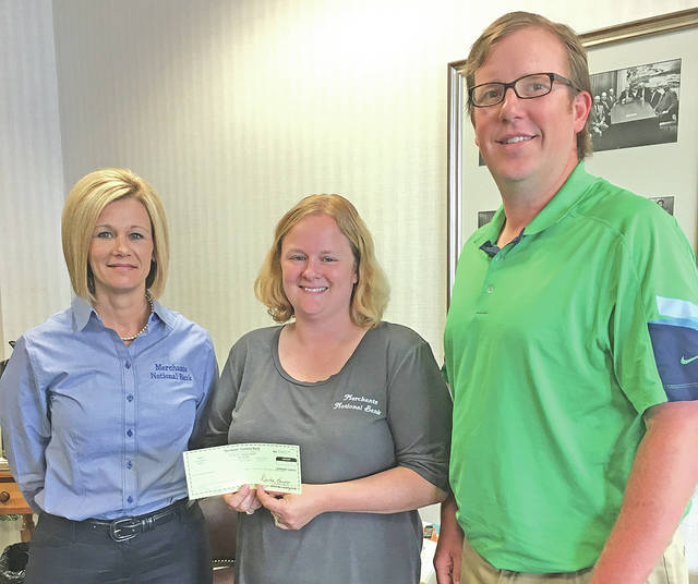 """Merchants National Bank has made a donation to the Highland County Shepherds Club to sponsor the Guys and Gals Wool Lead held by the club at the 2017 Highland County Fair. """"The Shepherds Club greatly appreciates Merchants sponsorship and their strong support of the local youth and agricultural community,"""" said Beth Roehm, club secretary. Pictured, from left are Denise Fauber, MNB vice president of operations; Beth Roehm, Shepherds Club secretary; and Scott Hopf, MNB chief financial officer."""