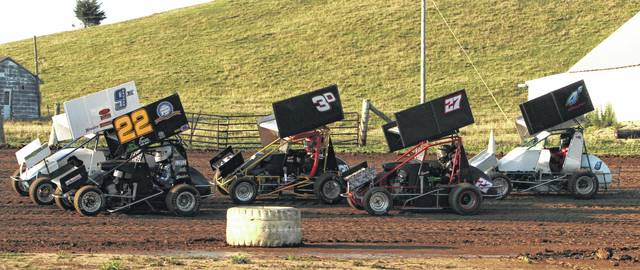 Drivers in the mini sprint class participate in the first hot laps of the night on Saturday at 35 Raceway Park in Frankfort, Ohio.