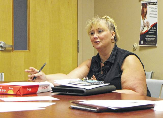 Heather Gibson, CEO of REACH for Tomorrow and president of the Highland County Drug Abuse Coalition, speaks during a coalition meeting Thursday at the North High Business Center in Hillsboro.