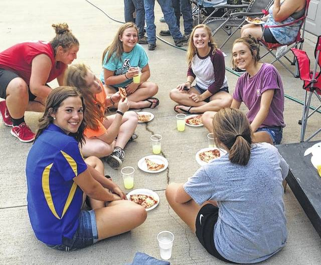 Members of the Hillsboro FFA chapter enjoy pizza at a recent meeting.