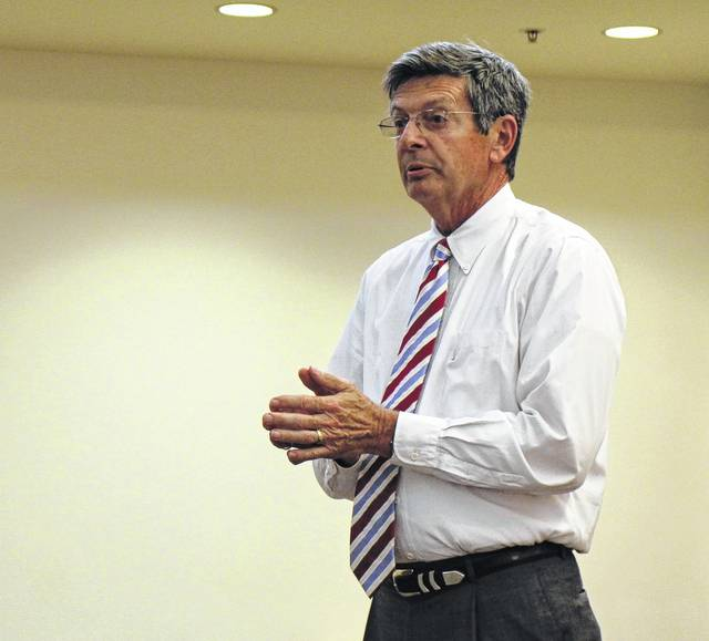 Judge David McKenna speaks to a group of former and current addicts, as well as family, friends, treatment professionals and law enforcement at a Monday event celebrating seven people who successfully completed Highland County's Vivitrol program.