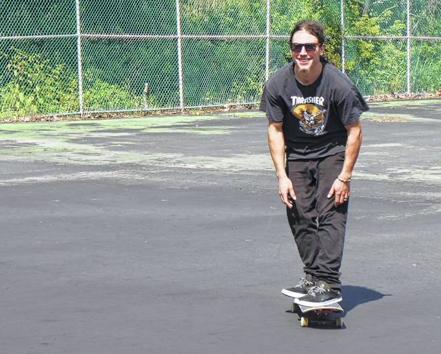 Pietro Cartaino, a Hillsboro resident and local skater, tests out the old tennis courts at the city park on Railroad Street.