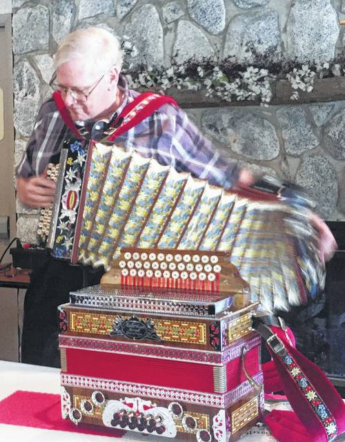 Local musician Bob Prosek performs a polka tune on a vintage 1946 Steinberg accordion during a Hillsboro Rotary Club meeting this week. Prosek, a former national accordion champion, discussed the history of the accordion and his own background in playing and collecting various makes of the instrument. In the foreground is another of his accordions, a 1972 Melodie model. Prosek is vice-president of the Highland County Airport Authority.