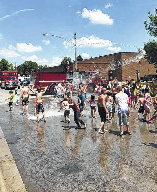 "Local kids gather in Greenfield recently for some fun in the sun at a ""water day"" courtesy of Paint Creek Joint EMS/Fire District. The district recently announced it will hold a water day in the parking lot of the North East Street Fire Station in Hillsboro on Monday, July 31 at 1 p.m. A post on the district's Facebook page said the community's response to Greenfield's water days in previous years was ""so overwhelming,"" district officials decided to host the event in Hillsboro as well. The water day will begin immediately following the Hillsboro City Schools' summer lunch stop in the fire station parking lot. Paint Creek public information officer Branden Jackman said the district hopes to host one more water day in Hillsboro before school starts."