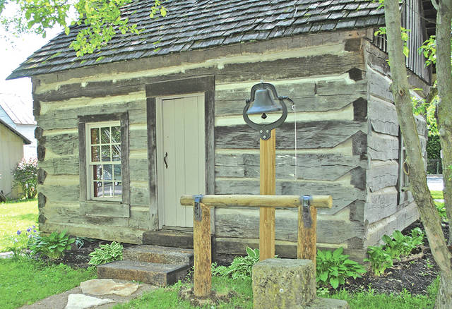 This log cabin that now rests behind the Highland House Museum in Hillsboro was originally built around 1830 along Mad River Road about 2.5 miles from New Market.