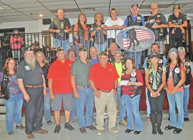 Members of the Hillsboro Eagle Riders are pictured Monday making a $3,700 donation to members of the local Disabled American Veterans (DAV). The funds came from proceeds of the second annual Poker Run to Benefit the DAV that was held May 20 by the Eagle Riders. The event included a ride from the Highland County AmVets on North Shore Drive to the Greenfield VFW, Wilmington American Legion, Blanchester Eagles and then back to the Hillsboro Eagles, where there was live music, drawings, raffles and an auction after the ride.