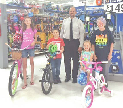 Pictured in the photo are Isabelle Boyd; Xander Boyd; Josh McCoy, Greenfield Adena Medical Center administrator; Malaia Simmons; and Sharon Aukeman, Greenfield Library branch manager.