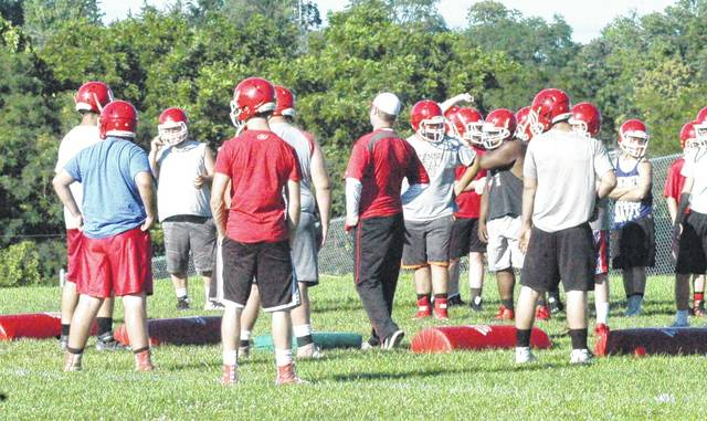 Hillsboro High School Indians varsity football teams take instruction at the start of summer practices in 2017.