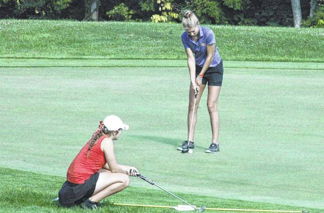 Bryn Karnes putts while Kristin Jamieson observes from the edge of the eighteenth green on August 8 at the Adam Sharp Memorial Tournament.