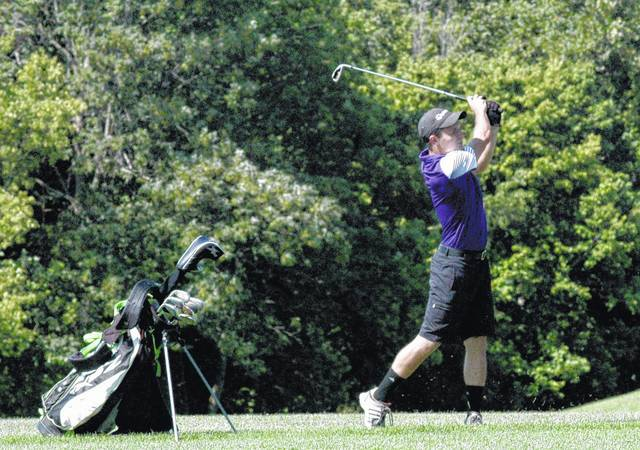 Trevor Newkirk, of McClain High School, hits his approach shot from the fairway of the ninth hole on Tuesday at Buckeye Hills Country Club during the Adam Sharp Memorial.