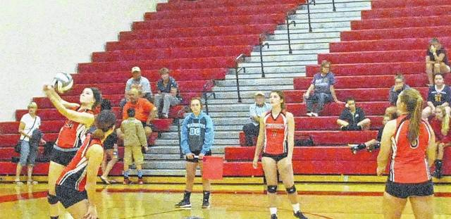 The Whiteoak Lady Wildcats volleyball team tries to defend the Lady Tigers serve on August 19 at the Highland County Spike and Dig Tournament.