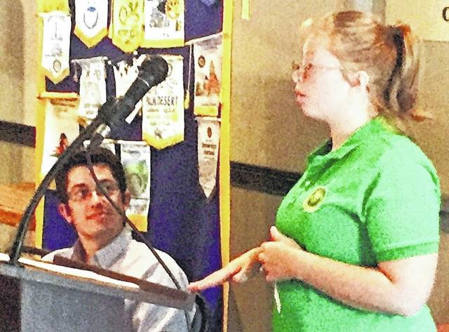 Cerena Kibbey, 18, the daughter of Jeremy and Brandy Kibbey of Highland, addressed Hillsboro Rotarians on Tuesday, describing her recent trip to China to work in a panda refuge as part of a Girl Scout Destination Trip. Kibbey is a member of Girl Scout Troop 1993, and will be a senior at Fairfield High School and at the Laurel Oaks animal science course. She said she loves pandas, and hopes to become a veterinarian. She was introduced by Rotarian Dan Pearce, who is also a grant coordinator for Hillsboro Elks, which helped fund the trip. The meeting took place at the Ponderosa Banquet Center. Also shown is Rotary president Reid Sharp.