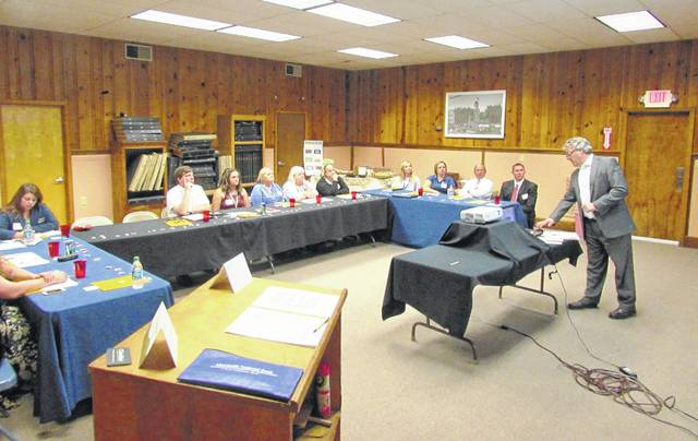 Attorney James Yates, right, of the Eastman & Smith law firm of Toledo, updated business officials on changes in labor and employment laws during a meeting Friday hosted by the Highland County Chamber of Commerce at The Times-Gazette's conference room.