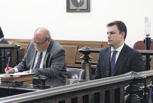 Seth Parshall, right, sits in Highland County Common Pleas Court with defense attorney Bruce Wallace on Wednesday.
