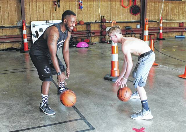 Tirrell Berland Left Dribbles With Logan Bieler At The Old Warren Furniture Warehouse On