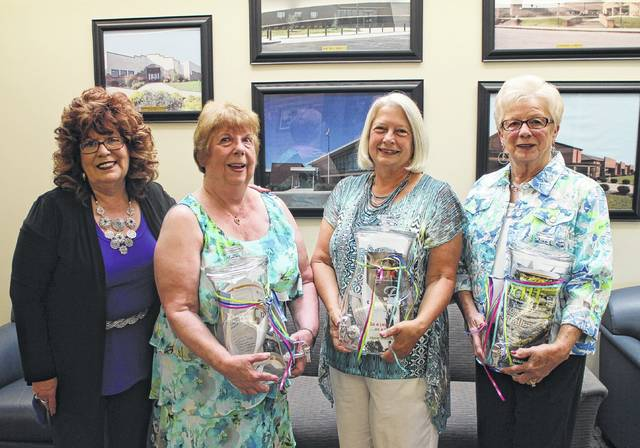 """Shown from left are Times-Gazette Media Sales Director Sharon Hughes and 2017 Highland County Women's Hall of Fame inductees Margaret """"Peggy"""" Addington, Karen Faust and Janet Butler. The inductees are shown holding gifts sponsored by The Times-Gazette."""