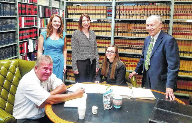 Shown are the volunteers who helped with the free family law clinic in June , from left: local attorney Rich Federle; assistant Clinton County prosecutor Katie Wright; Anne Lucas, managing attorney of the Volunteer Lawyers Project; clinic administrator Jayme Mabry; and local attorney Mitch Lippert.