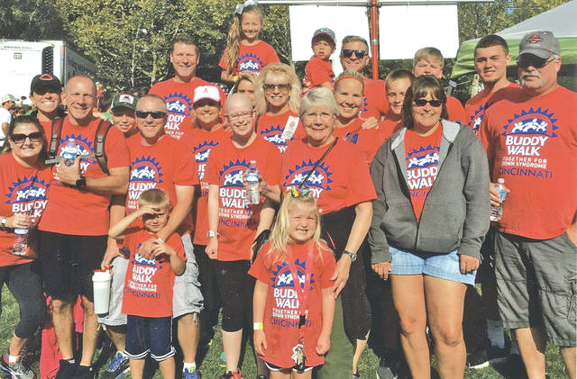 Elizbeth Wait (fourth from left in first row of adults) is pictured with several of her friends and family at the 16th annual Down Syndrome Buddy Walk held Sept. 9 at Sawyer Park in Cincinnati. Wait is an employee of Highco in Hillsboro. Highco had a collection bucket placed in an entrance hallway with Wait's picture on it in anticipation of the walk and more than $150 was placed in it for Wait and the Down Syndrome Society. Then Highco matched that amount to bring the total to $315.50. The McCann and O'Connor families were appreciative of the efforts on Wait's behalf. In all, the group collected $700 for the Down Syndrome Society.