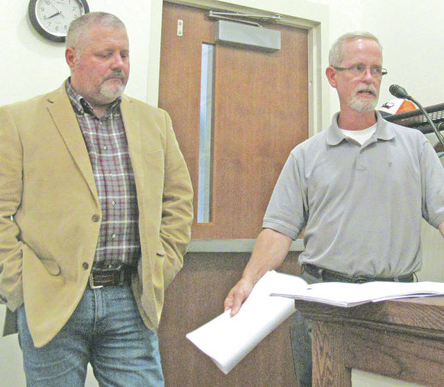 Scott Benner, right, and Doug Karnes spoke to Greenfield Village Council on Wednesday about their idea to begin a micro-brewery at the Elliott Hotel.