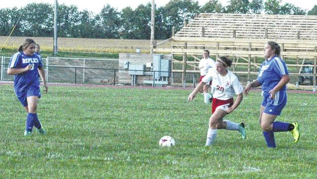 Alexia Sheppard maneuvers between two Ripley defenders on Wednesday at Fairfield High School. Sheppard recorded a hat trick to lead the Lady Lions to a victory.