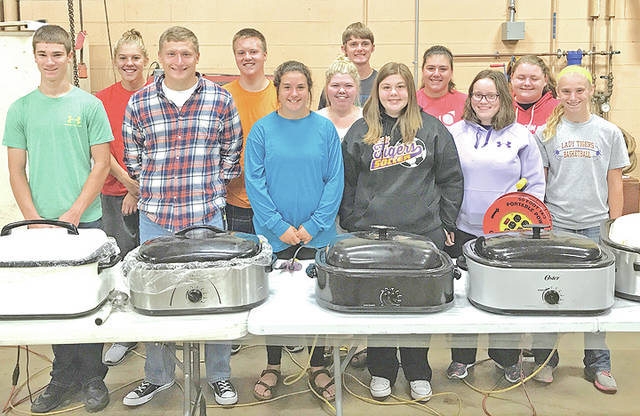 The McClain FFA Chapter held its first community service project Tuesday, Sept. 12. The members of the chapter prepared meals and distributed them around the community in order to raise money for the Harvey Flood victims in Texas. The meals included smoked pork, green beans, macaroni and cheese, a roll, cookies and water. The price of the meal was $7. Three hundred individuals from the community ordered meals, raising $2,100. Thank you to Craig and Amy Faulconer, Catch 22, Ian and Angie Trefz, Save A Lot, and the surrounding community for purchasing meals. The chapter appreciates the unwavering support of the community and its help in the inspiring task of impacting these victims.