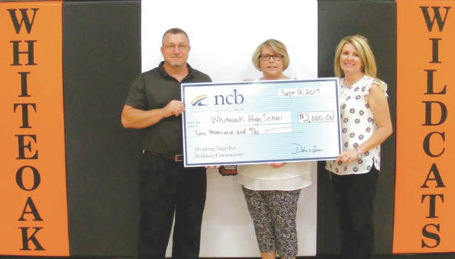 Pictured, from left, are Gary Arledge, Whiteoak High School math teacher; Kathy Dietz, Whiteoak High School former JOGS teacher; and Heather Cummings, NCB marketing manager.