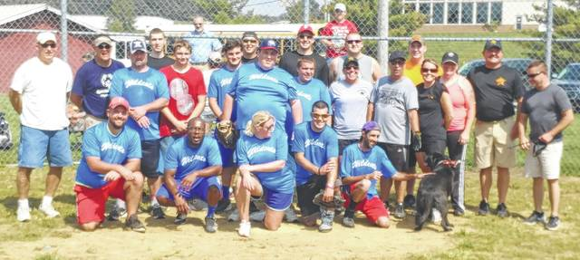 The Highland County Special Olympics Wildcats softball team poses with members of the Highland County Sheriff's Office following their softball game on Friday at Liberty Park in Hillsboro.