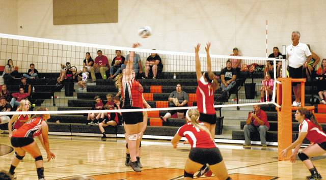 Ciara Maynard (34) of Whiteoak attempts a kill while Breanna Barnes (17) of Fairfield attempts to block on Tuesday at Whiteoak High School in SHAC volleyball action.