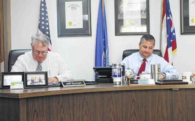 Highland County Commissioners Jeff Duncan, left, and Shane Wilkin, right, sit in session during a Wednesday commissioners meeting.