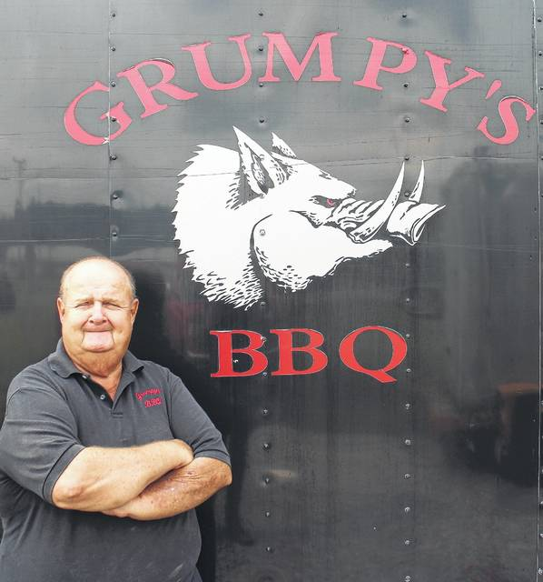 """Michael """"Grumpy"""" Wagner stands next to his barbecue trailer on Tuesday at the Highland County Fair."""