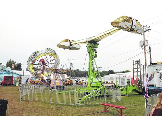 The ride shown in the foreground reportedly malfunctioned Sunday night, resulting in minor injuries and a 10-minute wait for passengers at the top.