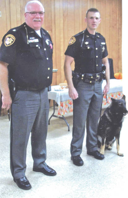 Highland County Sheriff Donnie Barrera, left, is pictured HCSO Sgt. Craig Seaman and the department's trained guard dog, Jango.