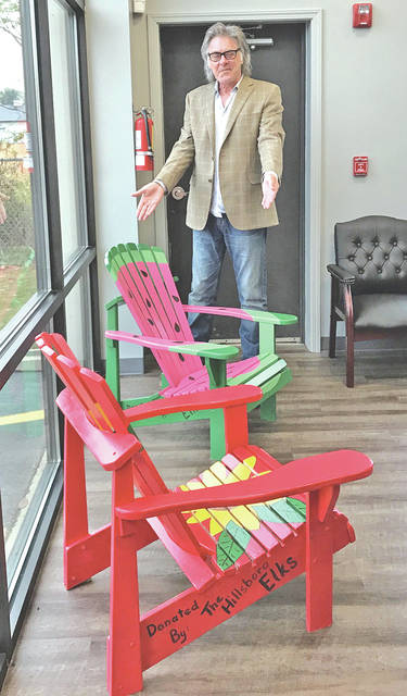 The Hillsboro Elks Lodge recently provided $750, which earmarked for use by a municipality, to the city of Hillsboro to purchase decorated chairs from Hills and Dales. The chairs will be used in uptown Hillsboro in the spring. Hillsboro Mayor Drew Hastings is pictured with two of the chairs to be placed in the city's historic district.