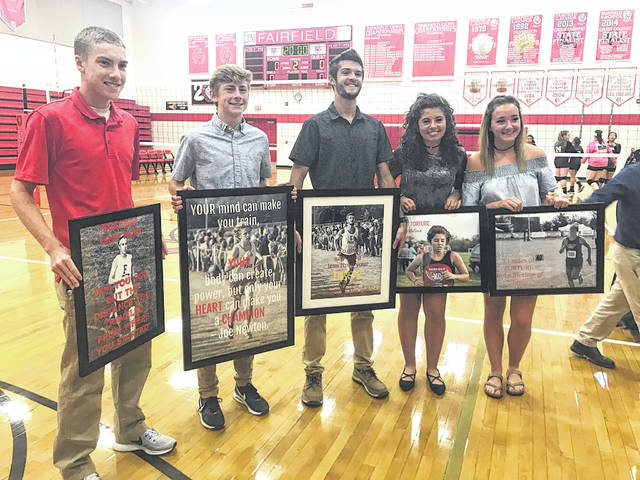 Seniors from Fairfield's boys and girls cross country teams are honored prior to Monday's volleyball game against Gerogetown. Pictured (l-r): Andrew Davis; Matthew Mangus; Noah Richmond; Chloe Barber; Sarah Young.