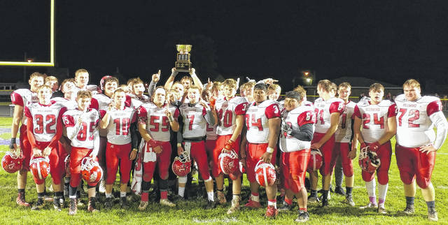 Hillsboro High Schools varsity football team poses for a picture on Friday at McClain High School after their 61-13 victory over the McClain Tigers in the Rotary Bowl.