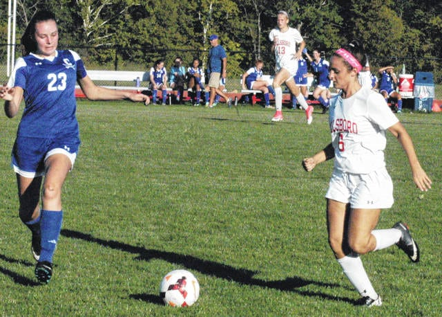 Ellie Elmore, a senior at Hillsboro High School, sprints to the ball on Tuesday in an attempt to gain possession for the Lady Indians against the Lady Cavaliers on Hillsboro's home field.