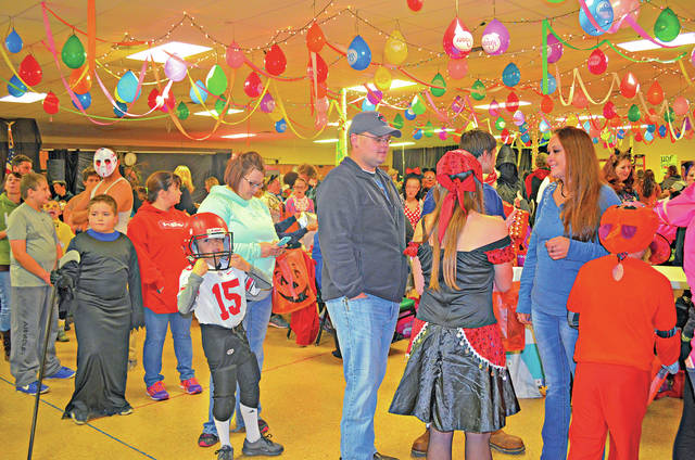 Shown here is a scene from a Halloween event held last Saturday at the Highland County Senior Citizen Center in Hillsboro. More than 500 people attended the event. For $1 those attending were able to trick or treat with around 25 businesses and individuals; go through a haunted house; play games; have a hot dog, chips and drink; participate in costume contests; and more.