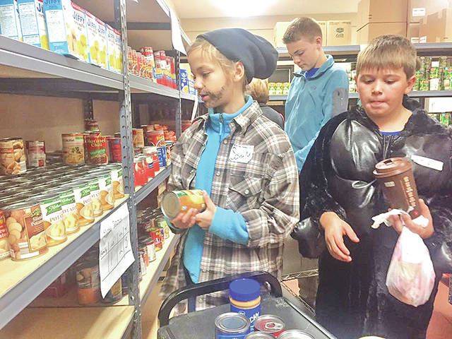 On Thursday, Oct. 26, from 6-8 p.m. during Greenfield's trick or treat night, students and adult volunteers from New Directions Youth Ministry in Greenfield will be going door-to-door collecting canned goods and other nonperishable items for the Greenfield Area Christian Center. Helpful food items include canned soup, canned fruit, canned vegetables, boxes of cereal, macaroni and cheese, spaghetti sauce and spaghetti. Because of the generosity of local residents, the youth from New Directions have collected hundreds of items every year that they deliver and stock on the shelves at the food pantry. For more information about this or other programs of the New Directions Youth Ministry, contact Mike Anderson, director of youth ministries, at 937-876-9868 or look for New Directions on Facebook.